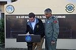 Secretary of defense signs a guest book as Brigadier General Bekir Ercan Van, 10th Base Commander Incirlik Air Base, Turkey looks on. 151215-D-LN567-039.jpg