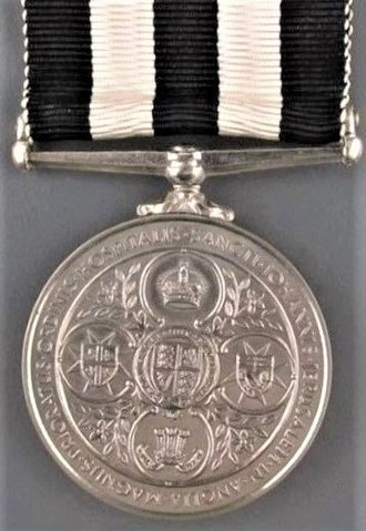 Service Medal of the Order of St John - Image: Service Medal of the Order of St John, reverse