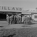 Sir Edmund Hillary and others in front of an airplane at Rongotai Airport, Wellington.jpg