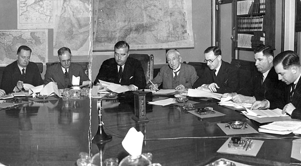Six Australian prime ministers - Forde, Curtin, Menzies, Hughes, Fadden and Holt - at a meeting of the Advisory War Council in 1940. Percy Spender (Minister for the Army) seated third from the right. Six prime ministers.jpg