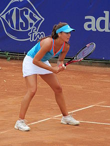 Sorana Cîrstea receiving a serve at the 2011 BCR Open Romania Ladies.jpg