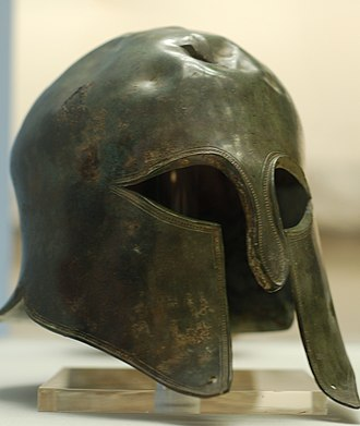 Spartan army - Spartan helmet on display at the British Museum. The helmet has been damaged and the top has sustained a blow, presumably from a battle.
