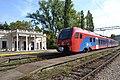 Stadler Flirt passing railway station Topčider (Belgrade).jpg