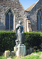 Statue in St Cuthbert's churchyard, Holme Lacy.jpg