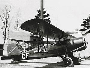 Stearman 4 - Stearman 4-C Junior Speedmail CF-CCH showing characteristic front manifold exhaust of the Wright J6 radial.