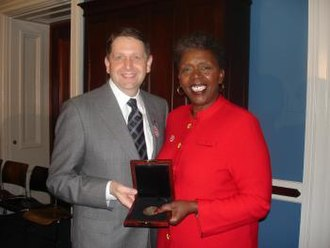 Stephanie Tubbs Jones - Marc Katz (left), President of the North-American Interfraternity Conference presents Tubbs Jones with the NIC Silver Medal.