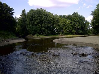 Sangamon River - View looking N/NE of the Sangamon (flowing from the right along the curve) and one of its tributaries, Stevens Creek (left), in Macon County, IL.