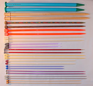 Knitting needle - Knitting needles in a variety of sizes and materials. Different materials have varying amounts of friction, and are suitable for different yarn types.