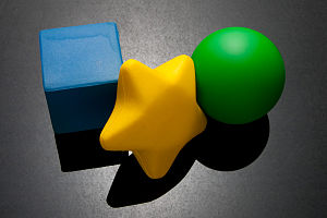 Molyneux's problem - Different shaped stress balls, including a cube, a star, and a sphere