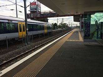 Swanson railway station - Photo of platform 2 facing east with an EMU in platform 1