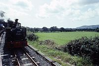 TR 0-4-2T No 7 'Tom Rolt' (ex Andrew Barclay 2263) from train, TR, N Wales 17.8.1992 (10196718856).jpg