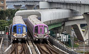 Taoyuan Airport MRT - Taoyuan Metro's Commuter (left) and Express (right) motor units at Linkou station.
