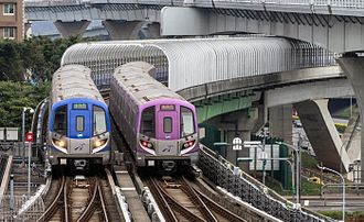Taoyuan International Airport - Taoyuan Airport MRT Commuter (left) and Express (right) trains.