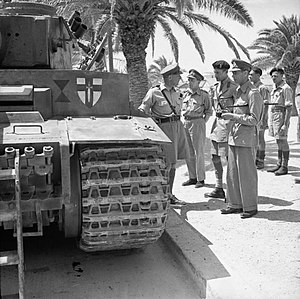 Tiger 131 - King George VI inspects Tiger 131, Tunis June 1943. The badge of the British First Army has been painted onto the tank