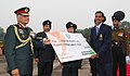 The Chief of Army Staff, Gen. V.K. Singh presenting a cheque of Rs. three lac to Sub Bajrang Lal Takhar, who won the Gold Medal in the Rowing at the Asian Games Guangzhou, at a function, in New Delhi on November 25, 2010.jpg