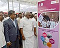 "The Minister of State for Road Transport & Highways and Shipping, Shri P. Radhakrishnan visiting the photo exhibition, at the ""Sabka Saath Sabka Vikas"" Sammelan, organised by the Chennai Port Trust, at Tondiarpet, in Chennai (1).jpg"
