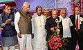 The President, Shri Pranab Mukherjee lighting the lamp at the inauguration of the Adamya Chetana-Midday Meal Kitchen for over one lakh children, at Bengaluru.jpg