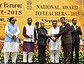 The President, Shri Pranab Mukherjee presenting the National Award for Teachers-2015 to Shri Brajesh Kumar Jadon (Delhi), on the occasion of the 'Teachers Day', in New Delhi.jpg