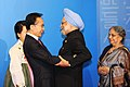 The Prime Minister, Dr. Manmohan Singh warmly welcomed by the President of South Korea, Mr. Lee Myung-bak, at the welcome reception of G-20 Summit, at National Museum, in Seoul, South Korea on November 11, 2010.jpg