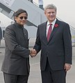 The Prime Minister of Canada, Mr. Stephen Harper being received by the Minister of State for Human Resource Development, Dr. Shashi Tharoor, at Air Force Station, Palam, in New Delhi on November 05, 2012.jpg