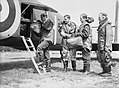 The crew of an Armstrong Whitworth Whitley bomber of No. 58 Squadron RAF load their parachutes on board their aircraft at Linton-on-Ouse, Yorkshire, prior to a sortie, June 1940. CH229.jpg