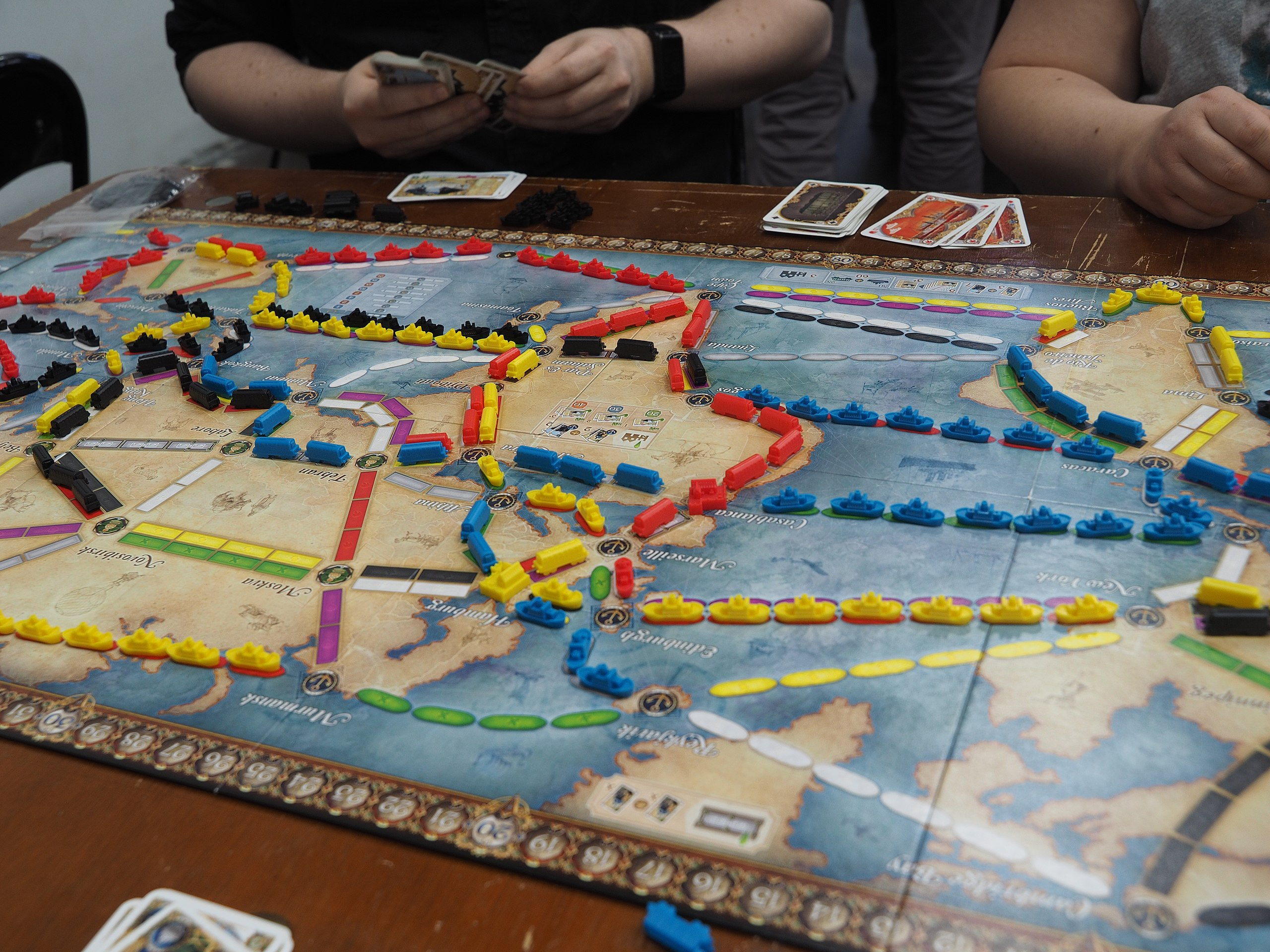 Playing Ticket to Ride at an annual board game festival in Helsinki, Finland; photo by JIP via CreativeCommons