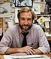 Tony Auth, cartoonist, working in front of sketches of his cartoons.jpg