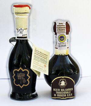 Balsamic vinegar - The two Italian traditional balsamic vinegars from Reggio Emilia (left) and Modena (right) with Protected Designation of Origin status (Denominazione di Origine Protetta in Italian), in their legally approved shaped bottles.