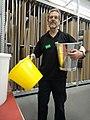 Trainee sales clerk holding two buckets 1.jpg