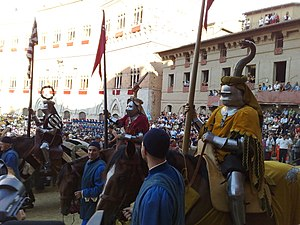 Contrade of Siena - The representatives of Oak, Spadaforte and Viper parade in the Corteo Storico