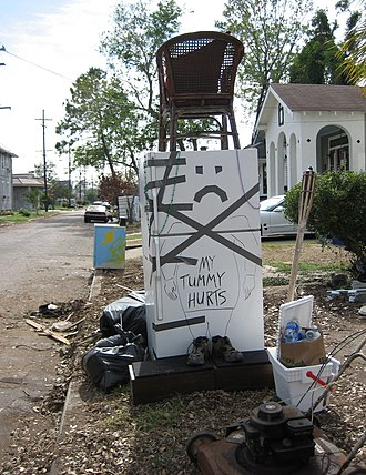 Katrina refrigerator - Refrigerator and other damaged item set on curb as trash made into a tableau