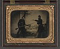 Two unidentified soldiers in Union uniforms posing with bayoneted Springfield Model 1861 rifled musket with attached bayonet, knife, and Colt Model 1851 Navy revolver in front of painted LCCN2010650759.jpg