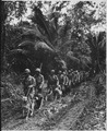 """U.S. Marine """"Raiders"""" and their dogs, which are used for scouting and running messages, starting off for the jungle... - NARA - 532372.tif"""