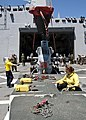 U.S. Navy Aviation Boatswain's Mate Handling 3rd Class Hannah Marihugh receives directions while moving an AH-1N Cobra helicopter on the flight deck of amphibious transport dock ship USS New York (LPD 21) 120413-N-XK513-111.jpg