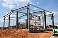 U.S. Sailors assigned to Naval Mobile Construction Battalion 11 construct a pre-engineered building for the technical trainer at the Naval Construction Battalion Center in Gulfport, Miss., May 8, 2013 130508-N-UH337-156.jpg