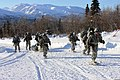 U.S. Soldiers assigned to the 4th Brigade Combat Team (Airborne), 25th Infantry Division, pull an ahkio sled packed with cold-weather survival gear while training during the Cold Weather Orientation Course 130327-A-FZ028-001.jpg