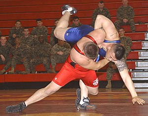 Masculinity - Contests of physical skill and strength appear in some form in many cultures. Here, two U.S. Marines compete in a wrestling match.