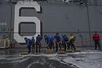 USS America deck scrubbing 140911-N-MZ309-056.jpg