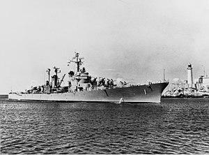 USS Norfolk (DL-1) entering port, circa in 1957 (NH 94162).jpg