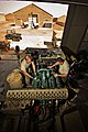 US Army 51931 CAMP TAJI, Iraq-Before removing an engine from a fuel truck, Spc. Austin Hunt (left), from Odessa, Texas, and Spc. Paul Aragon (right), from El Paso, Texas, both light wheeled mechanics in Company E.jpg