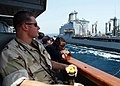 US Navy 020626-N-4374S-008 At sea aboard USS Cushing (DD 985) Jun. 26, 2002 - Ship's Commanding Officer, Commander Daniel Weed, observes an underway replenishment (UNREP).jpg