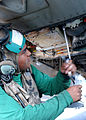 US Navy 020725-N-1280S-004 Sailor conducting maintenance on an F-14 Tomcat on the ship's flight deck.jpg