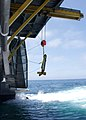 US Navy 020725-N-2354M-012 A Side-Scan Sonar Unit is lowered into the waters off the coast of California.jpg