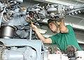 US Navy 020820-N-6268K-002 Sailor cleans rotor blades of SH-60 Seahawk.jpg