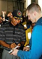 US Navy 040303-N-7340V-032 Professional Golfer Tiger Woods signs autographs for the crew after a golf ball driving demonstration aboard the nuclear powered aircraft carrier USS George Washington (CVN 73).jpg