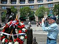 US Navy 040528-N-9909C-002 Stephen E. Kanyusik, a World War II veteran, takes some photographs of the Lone Sailor during the Navy's Battle of Midway Memorial Ceremony at the Navy Memorial in Washington, D.C.jpg