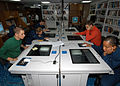 US Navy 040615-N-4190W-002 Sailors use computers to access the Internet in the ship's library aboard the conventionally powered aircraft carrier USS John F. Kennedy (CV 67).jpg