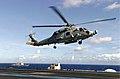 US Navy 040714-N-6213R-005 With the guided missile destroyer USS Howard (DDG 83) cruising alongside, an HH-60H Seahawk carrying Commander Pacific Fleet, Adm. Walter F. Doran, lands on the flight deck aboard USS John C. Stennis.jpg