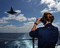 US Navy 040920-N-2143T-015 Boatswain's Mate 3rd Class Lois Oberlin of Angola, Ind., stands the aft look out watch on the fantail as an F-A-18C Hornet strike fighter prepares to make an arrested landing aboard USS Nimitz (CVN 68.jpg