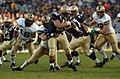 US Navy 041204-N-9693M-012 Navy full back Kyle Eckel breaks through defensive line at 105th Army Navy game.jpg